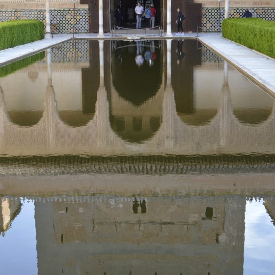 Alhambra reflections in one of the courtyards