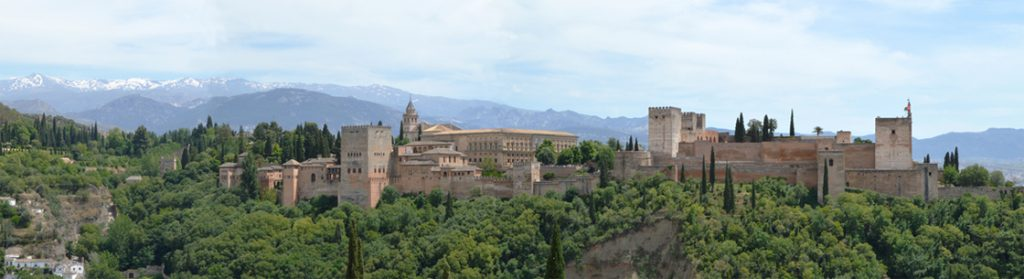 Alhambra Palace with Sierra Nevada mountains in the background