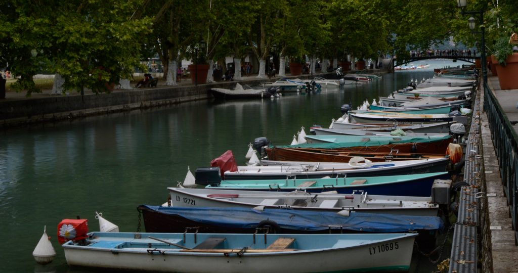 Annecy Canal with boats lined along the bank