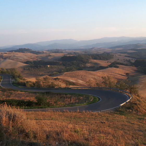 Winding Tuscan roads in the late afternoon