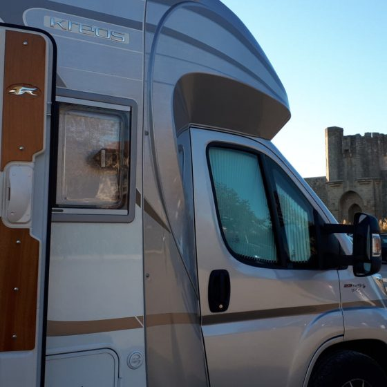 Buzz Laika the motorhome parked outside the walls of Aigues Mortes