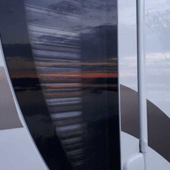 Lake reflections in the motorhome window