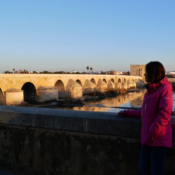 Cordoba Puente Romano with Marcella as the sunsets
