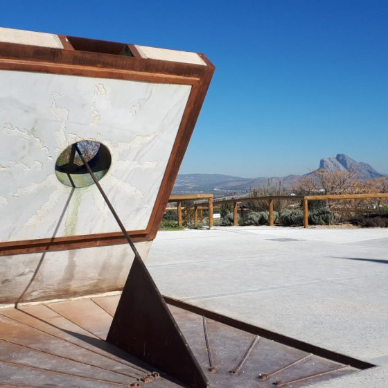 Sundial at the Antequera Dolmens visitor site with Lovers Leap in the background