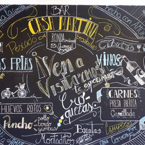 A tempting bar menu outside a Ronda restaurant