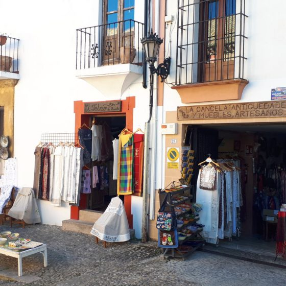 A colourful textiles shop in Ronda old town
