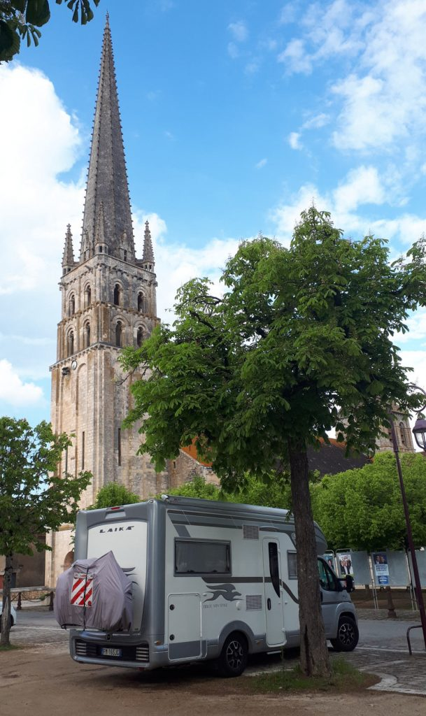 Buzz Laika parked in front of the Abbey of St Savin