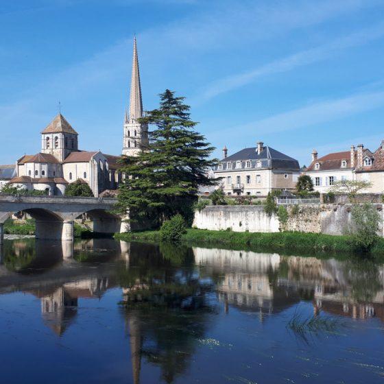 Beautiful reflections in St Savin's Gartempe river