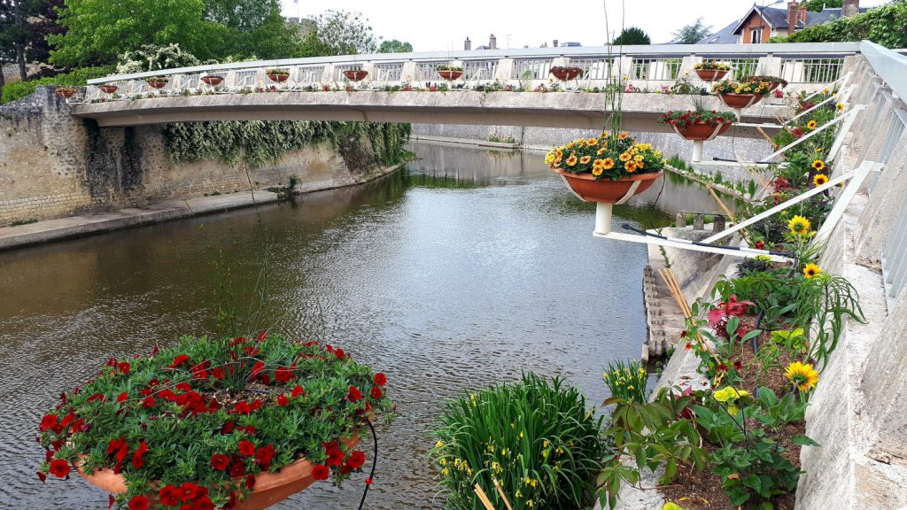 One of Vendome's many bridges decorated with colourful flower baskets