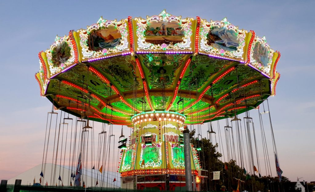 The colourful carousel at the entrance to the festival