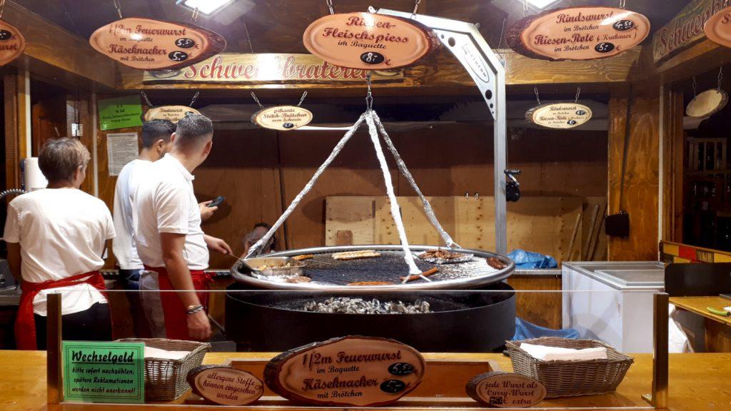 A huge sausage sizzling cooker