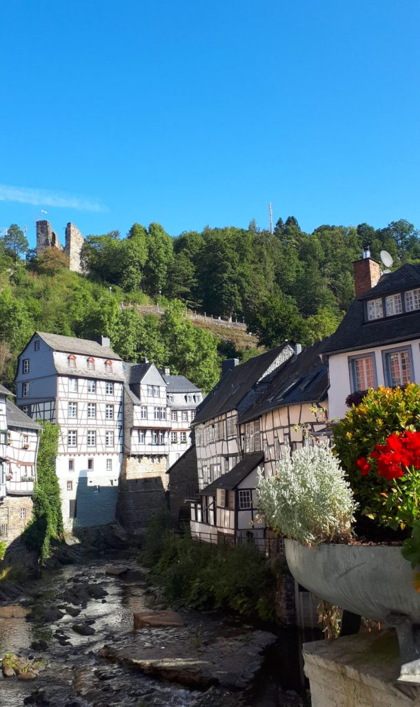 Beautiful Monschau with half timbered buildings lining the river