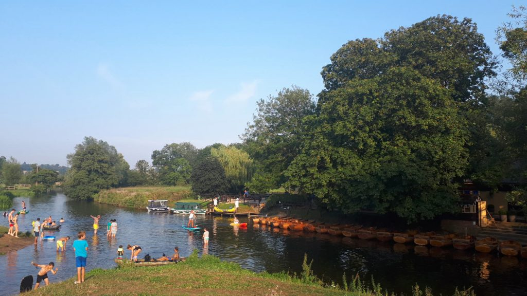 Families enjoying a dip in the Stour at Dedham