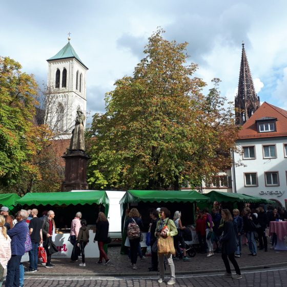 The busy market in Frieburg selling tasty Bretzels amongst other things