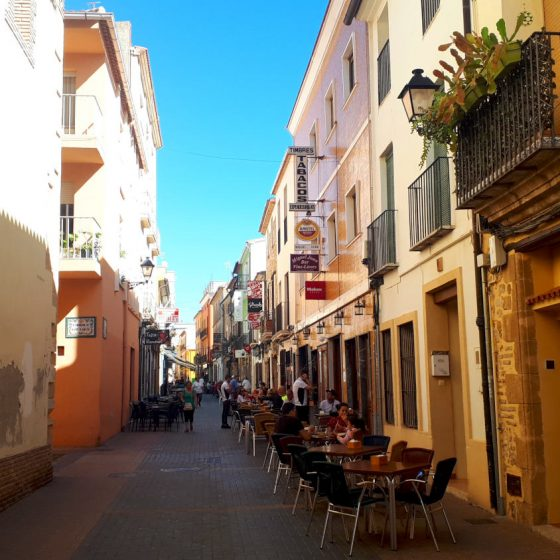 Denia old town street lined with tapas restaurants